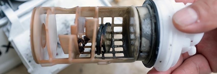 filtro de lavadora obstruido
